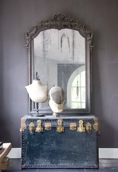 beautiful mirror sitting on a trunk. have to repaint my trunk and recreat this.