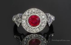 """Strikingly beautiful """"Pigeon Blood"""" red Burma ruby round 1.4 carats set in white gold with diamonds."""