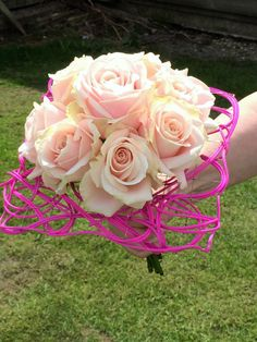 Very pretty pink traditional style brides wedding posy bouquet of sweet avalanche roses.... beautiful minimalist look but with a twist - mounted into a very modern contemporary hand crafted bouquet frame - you can have the best of both worlds after all... - created by Willow House Flowers - Aylesbury florist - www.willowhouseflowers.co.uk