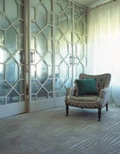 I love this rug and the mercury glass panels for the sliding doors