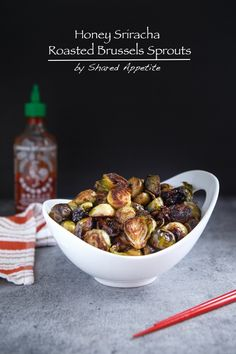 Honey Sriracha Roasted Brussels Sprouts--I know someone who will like these tomorrow night!