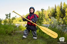 Young rafter on a rafting trip on Raudanjoki river in Lapland, with Safartica company.