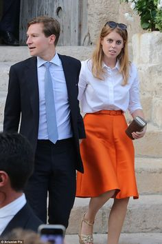 Princess Beatrice stood out from the crowd in a bright orange skirt as she left the ceremony with Dave Clark 19 Sep 2014