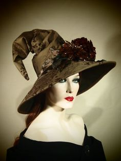 The base of this hat is made of a beautiful brown flocked twill and is adorned with amazing lacquered dahlias. This hat is fully lined and
