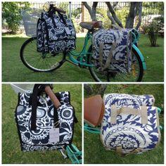 Alforjas dobles  Tela estampada Para realizar tus compras, desmonta y llévala como bolso. Reflectantes laterales Broches para fijarla a tu bici.