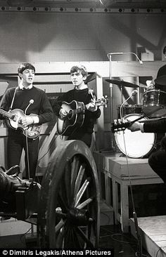 THIS IMAGE IS SUPPLIED FOR GUIDANCE ONLY, UNKNOWN COPYRIGHT.  COPY BY TOM BEDFORD MEDIA  Pictured: An archive photo circa 1963 showing John Lennon (R) playing his Gibson J-160E acoustic guitar on stage with Paul McCartney, George Harrison and Ringo Starr.  Re: An acoustic guitar, once owned by The Beatle's John Lennon, was sold at auction for a record $2.4 (£1.6), more than double its estimate.  The 1962 J-160E Gibson Acoustic Guitar was sold by Ju;lien's Auctions in Beverly Hills…
