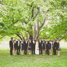 wedding party for the fall w navy and black with orange, reddish flowers