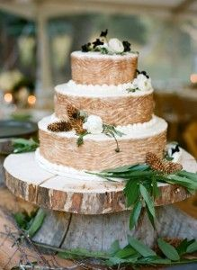 earthy wedding cakes | This tree bark cake is adorned with subtle leaf and pine cone accents.