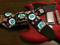 Cool guitar strap -- day of the dead kitties -- colourful cartoon skeleton cats on a black background by MyMumDrivesaUFO on Etsy