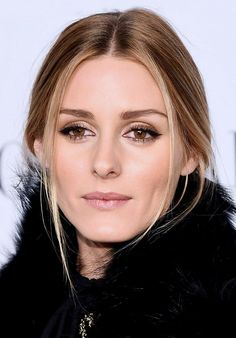 "Olivia Palermo is the epitome of ""party-ready"" with bronzed lids, subtle contouring, and lush lashes"