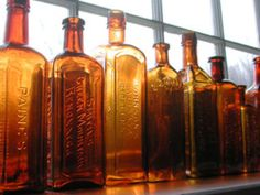 amber glass bottles look beautiful in the window light! Fill a whole window.