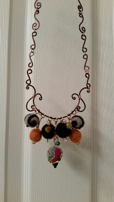 Hand crafted wire wrapped necklace,  neddle felted wool beads, with vintage beads mingled within, from The Felted Pearl.