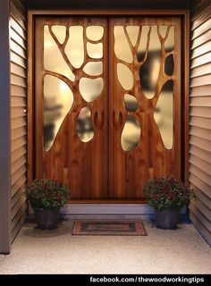 Cool door with tree design | More Woodworking Projects on http://www.woodworkerz.com