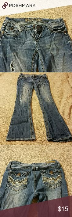 Distressed jeans Distressed jeans, with slight flare legs; back pockets with design and button closure Wallflower Jeans Flare & Wide Leg