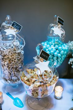 A Wish Upon A Star rustic baby shower featuring handmade centerpieces, spray painted letters, handmade banners, candy labels and thank you bags.