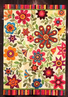 Spectacular colors. Wonderful appliqué.. if only this were a single fabric!