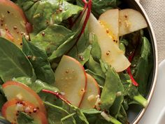 4 cups spinach-arugula salad mix   1 sliced apple   2 tablespoons roasted pumpkinseeds   2 tablespoons olive oil   2 teaspoons cider vinegar   1/2 teaspoon Dijon mustard   1/2 teaspoon honey  Combine olive oil, vinegar, mustard, and 1 honey in a large bowl, stirring with a whisk. Add salad mix, apple, and pumpkinseeds; toss.  94 Calories