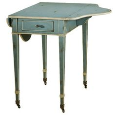 vintage inspired... love the wheels and colour/finish - Cantal End Table