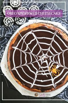 This isn't just an Oreo cheesecake, it's a spiderweb cheesecake. The perfect festive dessert for any of your Halloween celebrations. #HalloweenTreastWeek [ad] @DixieCrystals #spiderweb #halloweendessert #oreocheesecake #thespiffycookie