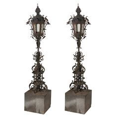Pair Of Old Iron Torchieres On Marble Bases. USA (1920)