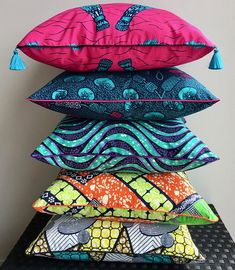 African wax print cushion with piping, pompoms and tassels Ankara pillows Cushion and cotton sheetCushion and cotton sheetIndustrial Pipe Window Cu Printed Cushions, Throw Cushions, Pillows, African Interior, African Home Decor, Estilo Hippy, African Accessories, African Fabric, African Prints