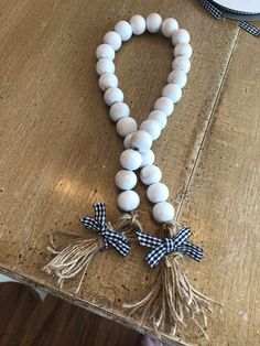 Farmhouse white wash beaded garland pairs well with any farmhouse style decor or trays Diy Tassel, Tassel Garland, Diy Garland, Garlands, Tassels, Christmas Bead Garland, Wood Bead Garland, Bead Storage, Book Crafts