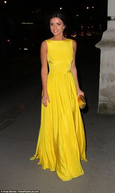 Making a statement: Lucy Mecklenburgh looked sensational in a bright yellow gown as she arrived at London's Victoria and Albert Museum on Thursday evening