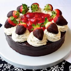 Rum Truffle Strawberry Cheesecake - http://www.rockrecipes.com/rum-truffle-strawberry-cheesecake/