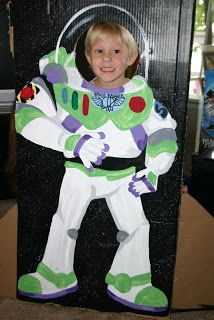 Buzz Light Year Photo Stand. Hand painted by a friend for Owens Birthday party. What little kid wouldn't want his/her picture in this?!