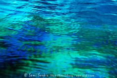 Iridescent oil floating on the surface of the water, Maldives ...
