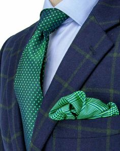 Patterned blue suit with green patterned tie