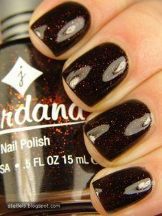 Jordana Wicked. (orange glitter in a black base)