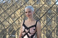 Michelle Williams cuts an elegant yet edgy figure for fashion launch #dailymail