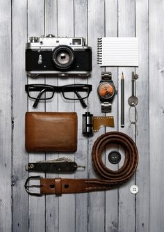 A camera, a belt, a watch and a wallet in a flatlay style layout. Creative still life photography of fashion accessories. By luxury goods still life p… – Sunglasses Photography Business, Life Photography, Photography Hashtags, Editorial Photography, Product Photography, Photography Essentials, Photography Classes, Iphone Photography, Object Photography