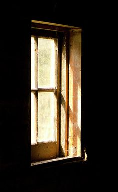 Light coming in through a small window of a Swedish barn at Old World Wisconsin. Given how many mice were running around inside, it's probably just as well it was dark.    Prints from $32