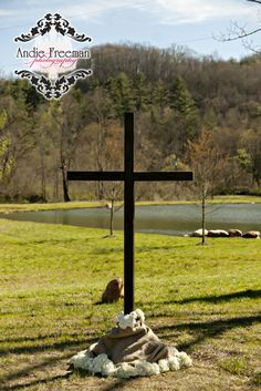 Red barn outdoor ceremony with altar cross in front of lake and mountains. Photography: www.TheAthensWeddingPhotographer.com Planning, Floral, and Event Design: www.WildFlowerEventServices.com Venue: Dillard, Ga