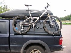 truck bed pvc bike rack on the side of the camper. Nice use of space.