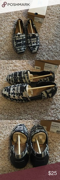 Toms Huarache slides Toms Huarache style slides. Super cute and comfy. Black/multicolor. Only worn once. All original packaging is included. TOMS Shoes Flats & Loafers