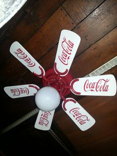 Coca Cola ceiling fan: Take any fan. Repaint the blades and all mechanisms the color desired and add sticker decals to finalize theme