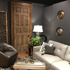 Eclectic room setting using farmhouse style door to bring your home decorations together.