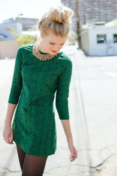 Love this green dress!!! Perfectly accessorized with dark tights, messy bun, and a glam necklace!