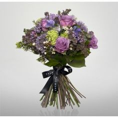 Cool Water made up of lilac roses, cool water roses and beautiful sweet peas and viburnum