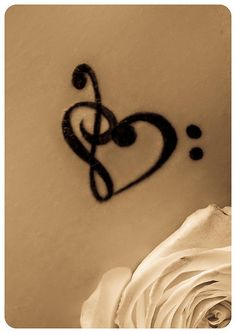 Treble/bass clef heart tattoo ... Uploaded with Pinterest Android app. Get it here: http://bit.ly/w38r4m