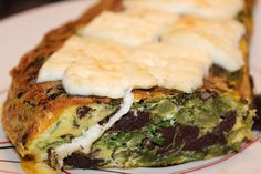 Black pudding and greens omelet with goat cheese