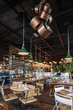 London-based architectural studio Michaelis Boyd has realised their first project in Dubai: Pots Pans & Boards - a new restaurant concept from. Restaurant Concept, Cafe Restaurant, Marmalade Cafe, Industrial Restaurant, Decorative Panels, Italian Recipes, Italian Foods, Retail Design, Coffee Shop