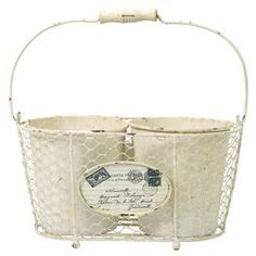 """Distressed iron basket with two pots and postcard-inspired emblem.    Product: Two pots and one basket    Construction Material: Iron    Color: White    Features:  Reminiscent of a French garden  Postcard graphic emblem on basket      Dimensions: 7.25"""" H x 12.75"""" W x 7.25"""" D (overall)"""