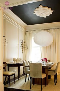 A Noguchi Akari lantern and a pitch-dark ceiling add a modern note to this dining room by the McGill Design Group. Different fixture for sure but love the drama of the black ceiling and medallion Dark Ceiling, Colored Ceiling, Accent Ceiling, Ceiling Rose, Ceiling Trim, Modern Ceiling, Molding Ceiling, Ceiling Panels, Ceiling Decor