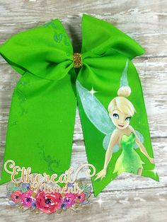 Tinkerbell hand painted cheer bow.  https://www.facebook.com/etherealmoments/  https://www.etsy.com/shop/EtherealMomentsShop?ref=pr_shop_more