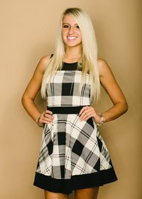 Plaid sleeveless dress with mesh shoulders and back and colorblock waist and hem.