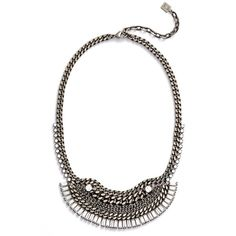 Edgy layered curb chains plated with vintage-inspired oxidized silver are accented by round and baguette-cut Swarovski crystals in a stunning bib necklace with…